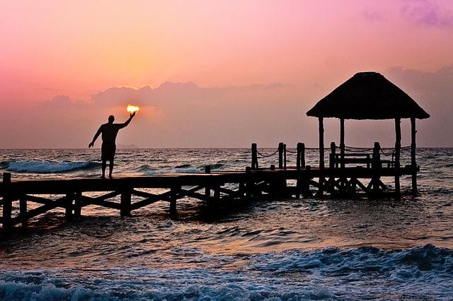 man-sun-holding-ocean-peer-waves