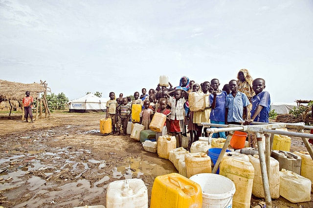 children-and-women-in-line-for-water-crisis-shortage
