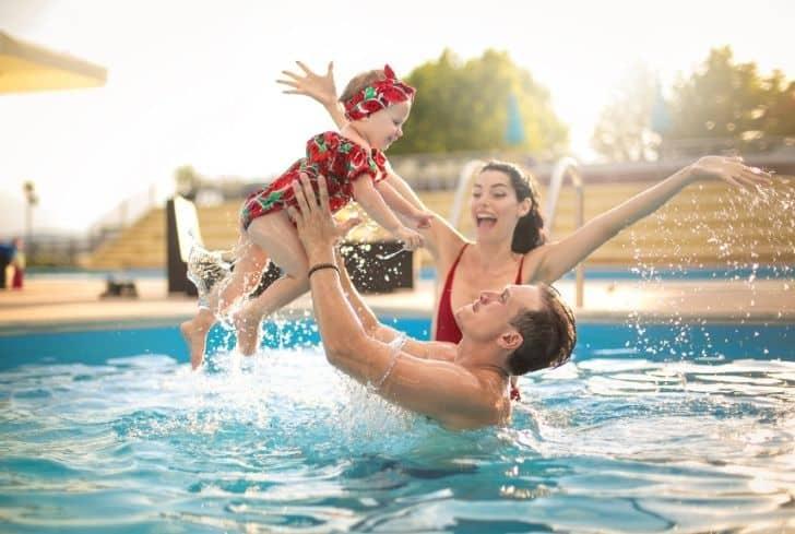 family-enjoying-in-swimming-pool