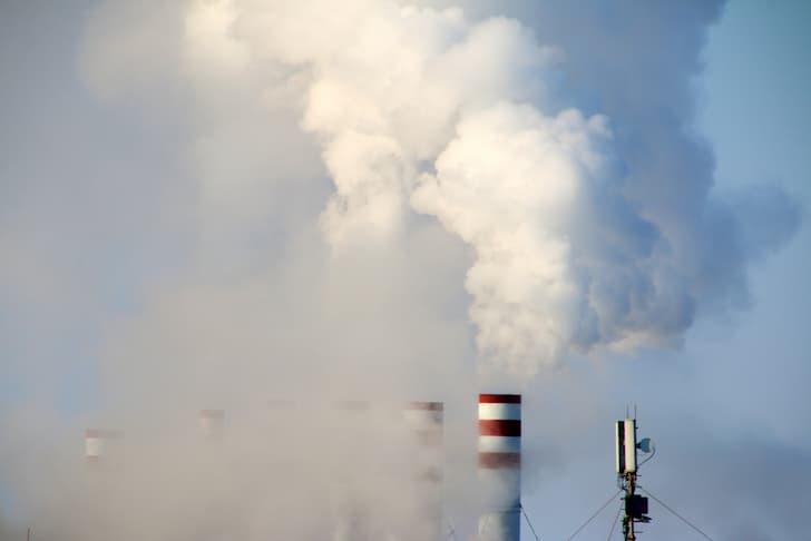 photo-triple-smoking-steaming-stacks-city
