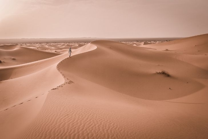 man-walking-alone-in-desert