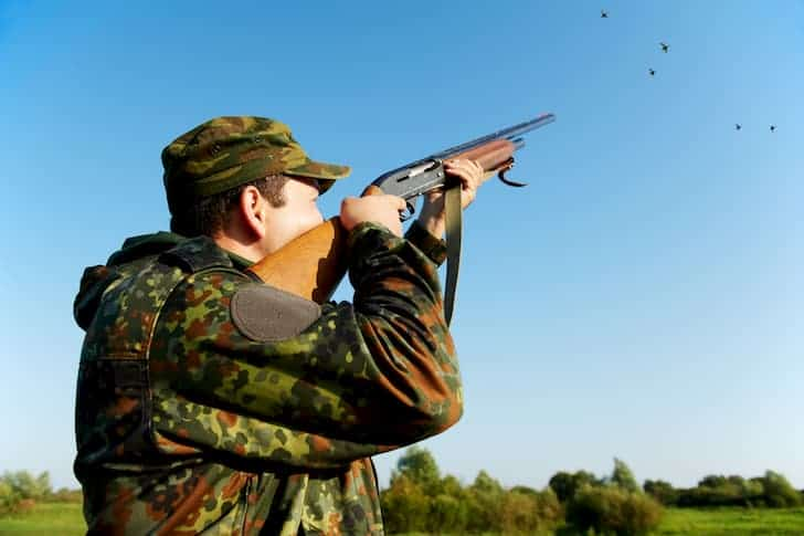 photo-hunter-shooting-with-rifle-gun