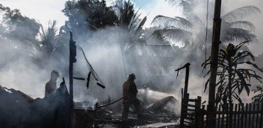 silhouette-of-fireman-holding-hose