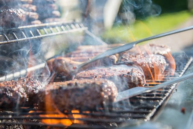 close-photography-of-grilled-meat-on-griddle