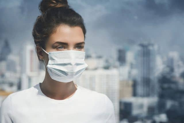 woman-wearing-mask-pollution-city