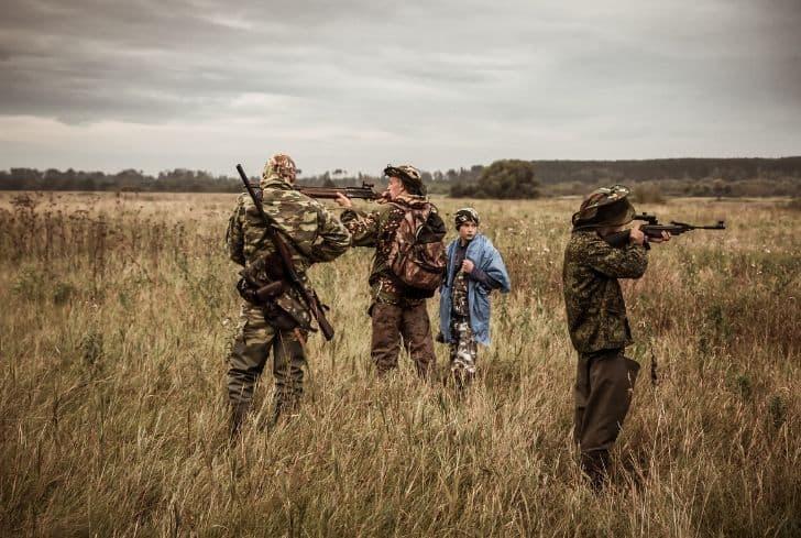 group-of-men-hunting-poaching