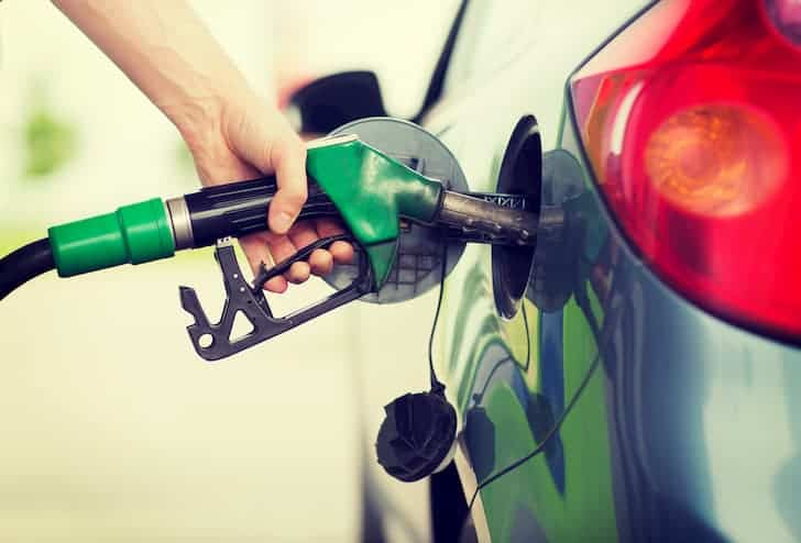photo-man-pumping-gasoline-fuel-in-car