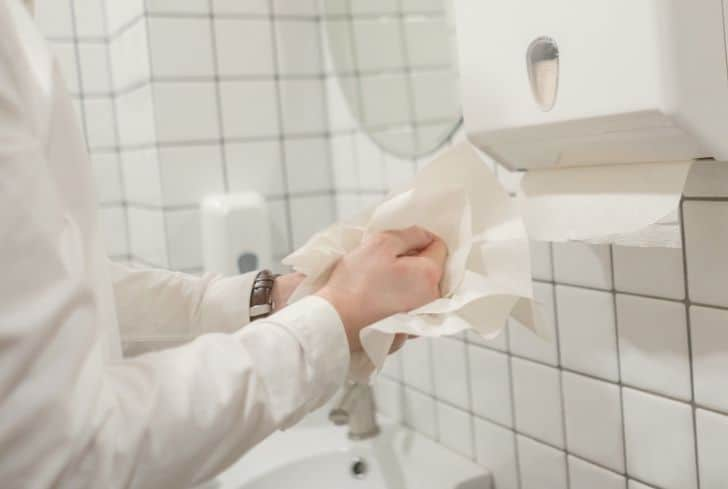 man-wiping-hands-with-paper-towel