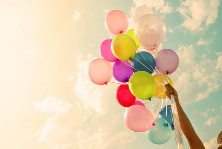 man-holding-balloons