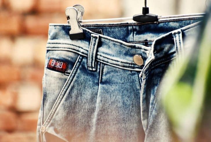 blue-denim-jeans-on-hanger
