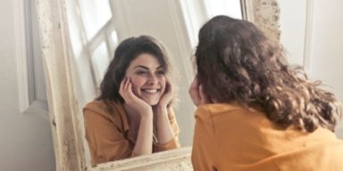 girl-watching-herself-in-mirror