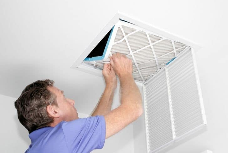 man-removing-dirty-air-filter