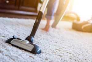 woman-using-vacuum-cleaner