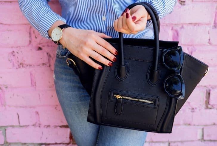 women-holding-black-leather-bag